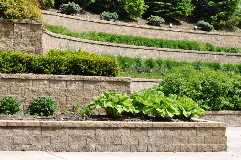 Natural Stone vs Segmental Retaining Walls